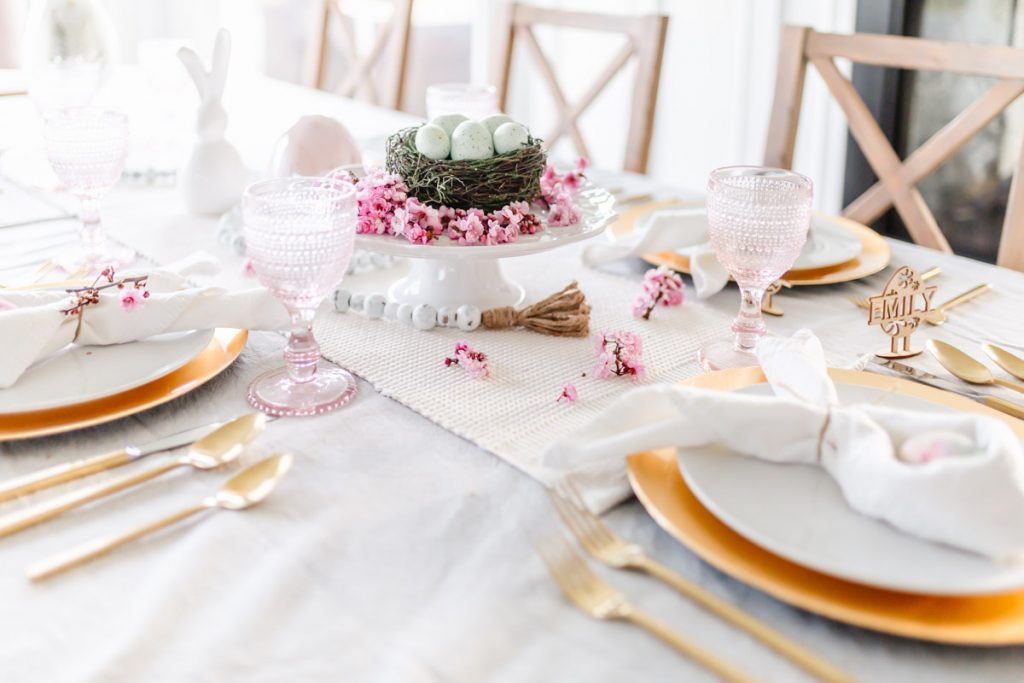 A pink and gold easter table setting