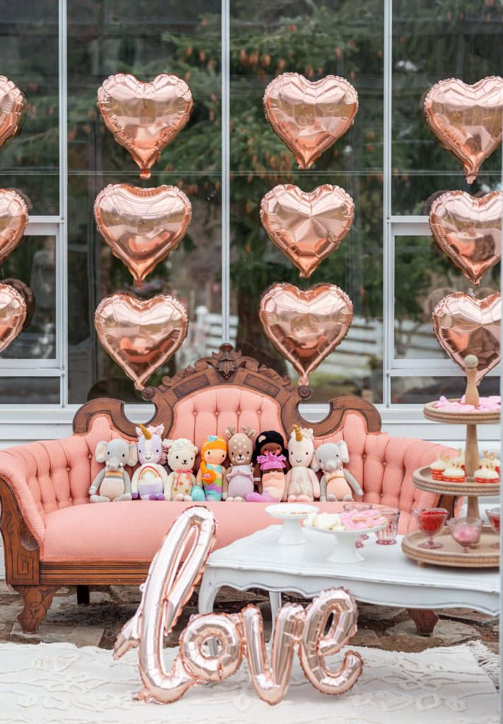 cuddle and kind dolls in a valentines mini greenhouse shoot